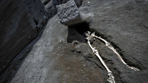 The discovery of this skeleton near Pompeii in Italy suggests a man attempting to flee the 79AD eruption of Mount Vesuvius died in a strange fashion. Picture: AAP.