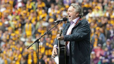 "Mike Brady, famous for his AFL anthems, performing ""Up There Cazaly"" at the 2013 Grand Final. (AAP)"