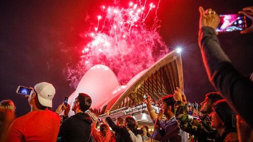 Fireworks explode over the Sydney Harbour Bridge and Sydney Opera House during the midnight display during New Year's Eve celebrations on January 01, 2020