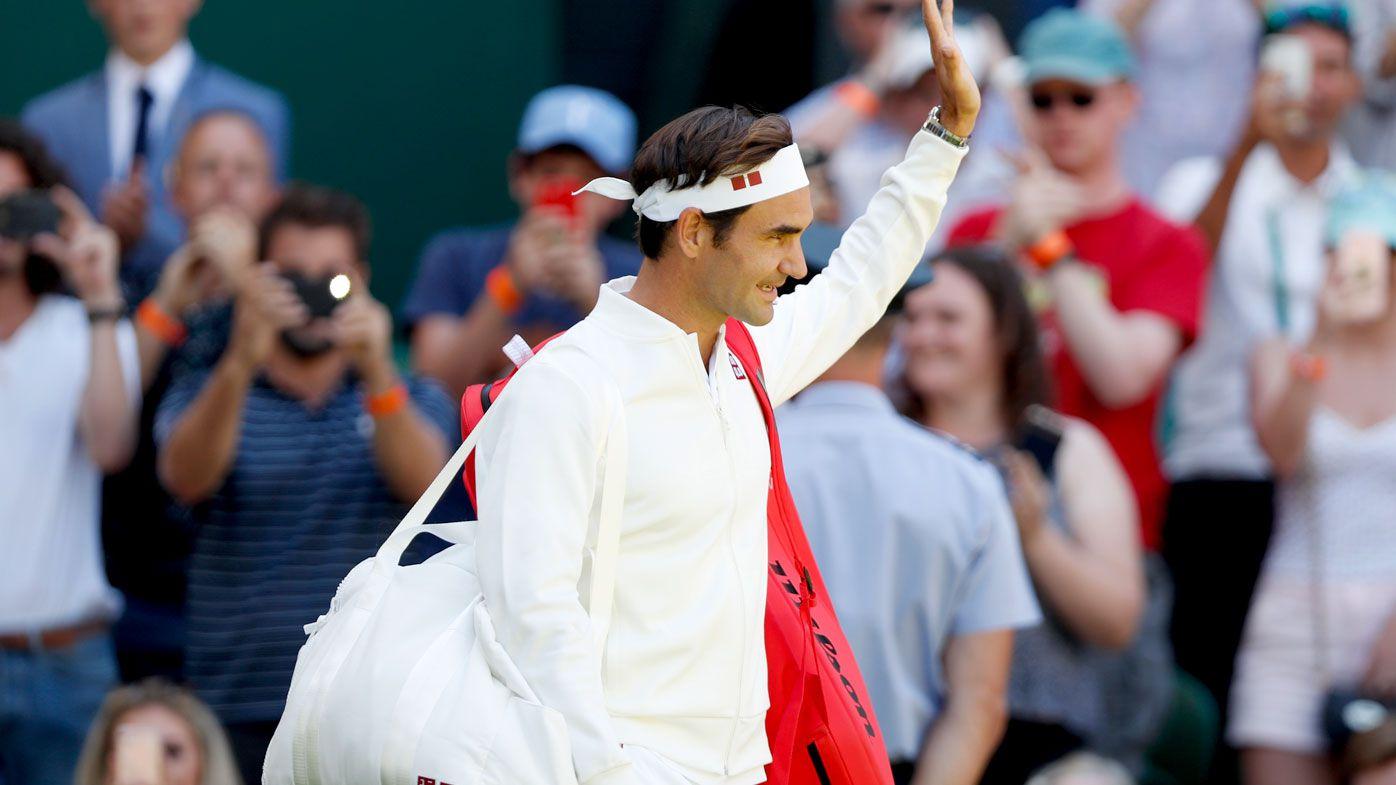 Roger Federer walks onto court at Wimbledon. (AAP)