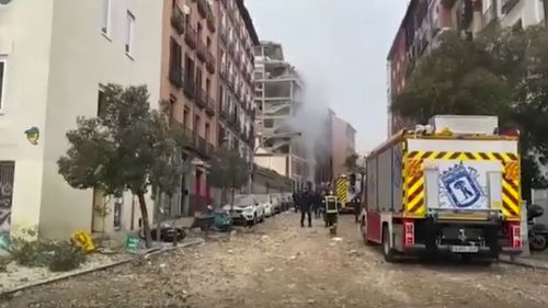 In this image made from video provided by Emergencias Madrid, firefighters attend the scene after an explosion in Madrid, Wednesday, Jan. 20, 2021.