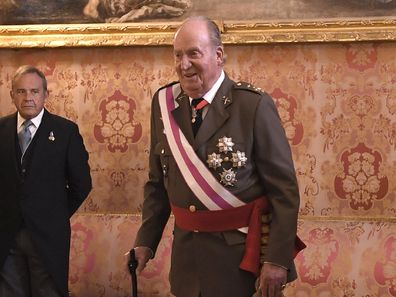 Former Spain's King Juan Carlos, left at the annual Epiphany Day celebrations at the Royal Palace in Madrid, Spain, Saturday, Jan. 6, 2018.
