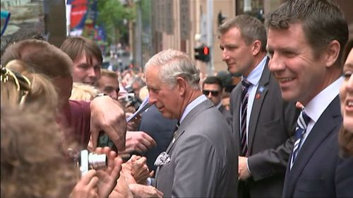 Prince Charles, accompanied by NSW Premier Mike Baird, makes his way through Martin Place. (9NEWS)