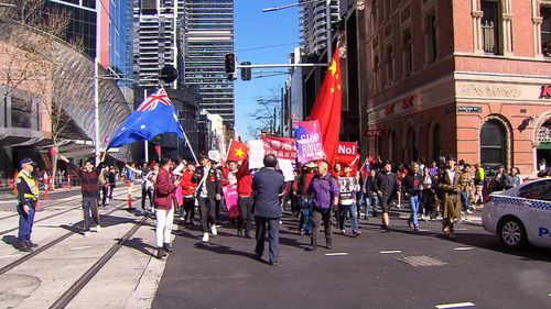 Activists have clashed with pro-China supporters in Sydney as thousands marched in Australia cities in response to ongoing protests in Hong Kong.