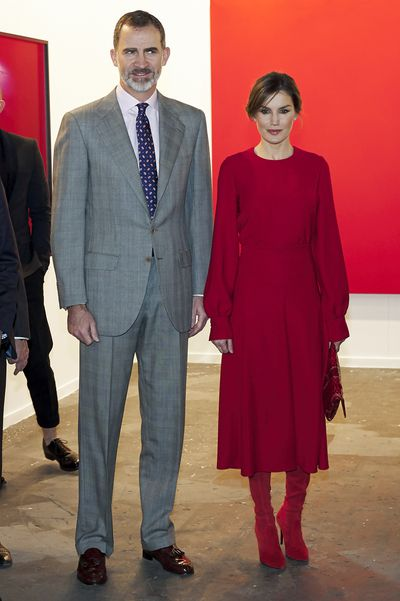 Queen Letizia in red suede Magrit over-the-knee boots  at the opening of ARCO (Contemporary Art Fair) at Ifema in Madrid, March 2018
