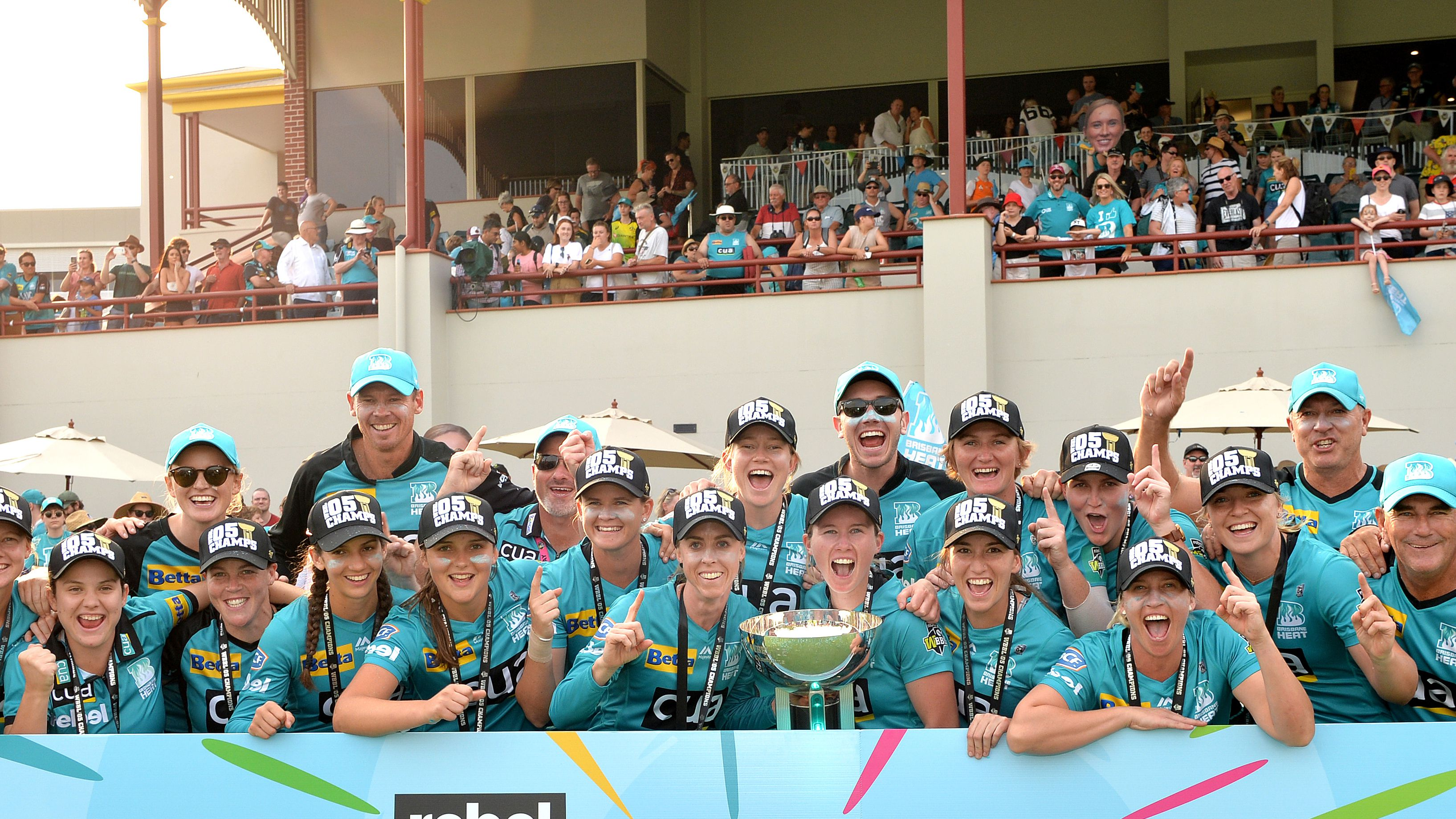 Beth Mooney and the Brisbane Heat celebrate the WBBL title.
