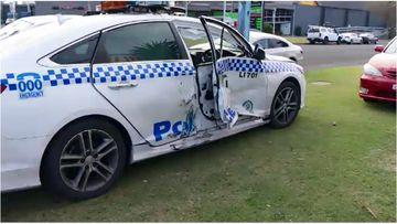 Two police officers have been injured following an alleged violent carjacking on the NSW South Coast.