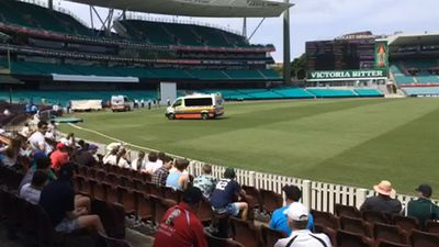 Paramedics rush onto the field after the incident. (9NEWS)