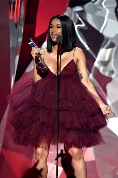 Cardi B accepting the Best New Artist award at the 2018 iHeartRadio Music Awards in California, March 2018.