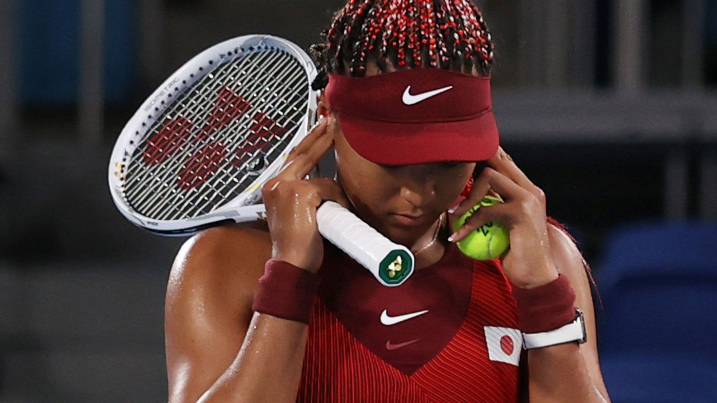 Naomi Osaka covers her ears before match point in her loss to Marketa Vondrousova at the Tokyo Olympics.