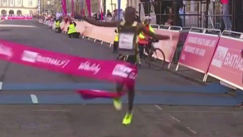 Marathon winner takes comical tumble