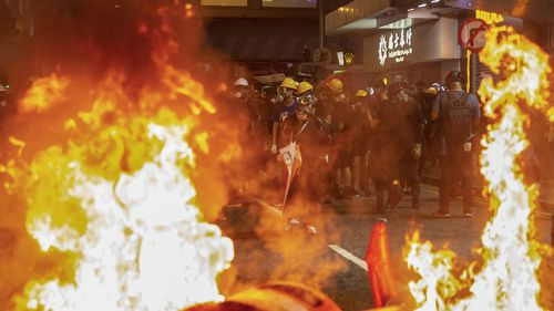 Bins are set on fire by anti-extradition bill protesters during a rally in Causeway Bay, Hong Kong.