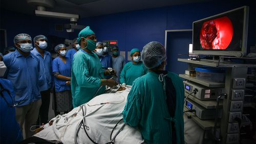 A surgeon removes infected tissue from a patient suffering from black fungus in Allahabad, India.