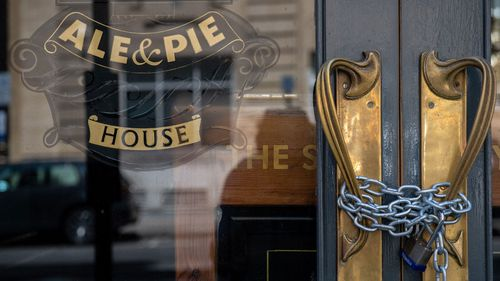 A lock and chain is in place across an entrance to a closed pub after further lockdown restrictions have been eased on June 23, 2020 in London, England