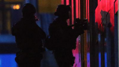 Two Special Operations Group officers stand ready to enter the Lindt cafe. (AAP)