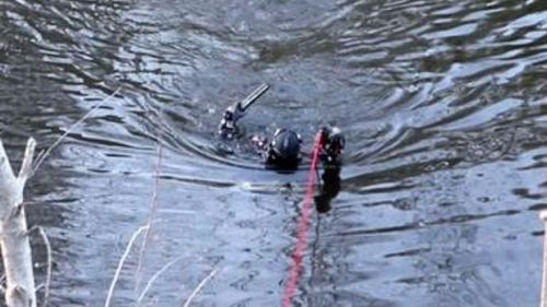 The firearm was located in the Queanbeyan River. (ACT Police)