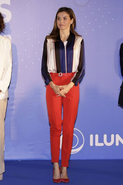 <p>The mother-of-one made a splash in a striped blouse and bright red cigarette pants from Hugo Boss at the Discapnet Awards in June. She paired her colour-blocking outfit with a navy and red Carolina Herrera 'Baret' clutch bag.</p>
