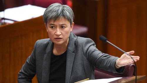 Labor Senator Penny Wong reacts during debate on the Nauru bill.