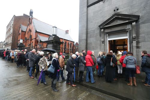 People queued for hours outside St Joseph's Church in Limerick to say their farewells to the 46-year-old singer (AAP).