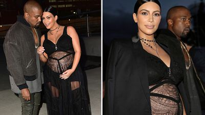 An expecting Kim Kardashian puts her pregnancy on show in a sheer black dress at the Givenchy show, with husband Kanye West. (Getty/AAP)