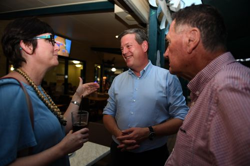 Tim Nicholls chats to pubgoers in Townsville yesterday. (AAP)