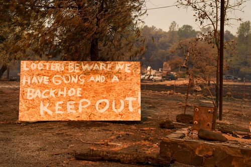 A sign on Highway 191 in Paradise warns looters to stay away after the Camp Fire destroyed the town