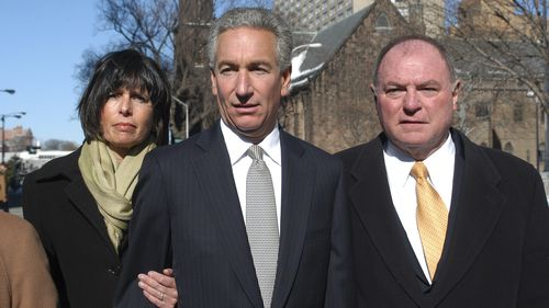 In this March 4, 2005 file photo, Charles B. Kushner, flanked by his wife, Seryl Beth, left, and his attorney Alfred DeCotiis arrives at the Newark Federal Court for sentencing in Newark, N.J.