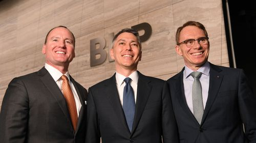 BHP Chairman Ken MacKenzie (left), BHP CEO-Elect Mike Henry (centre), BHP chief executive Andrew Mackenzie (right).