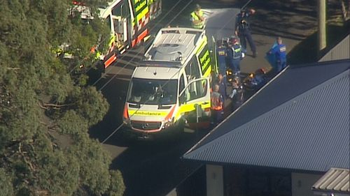 Paramedics work on site after early reports of a shooting in Engadine.