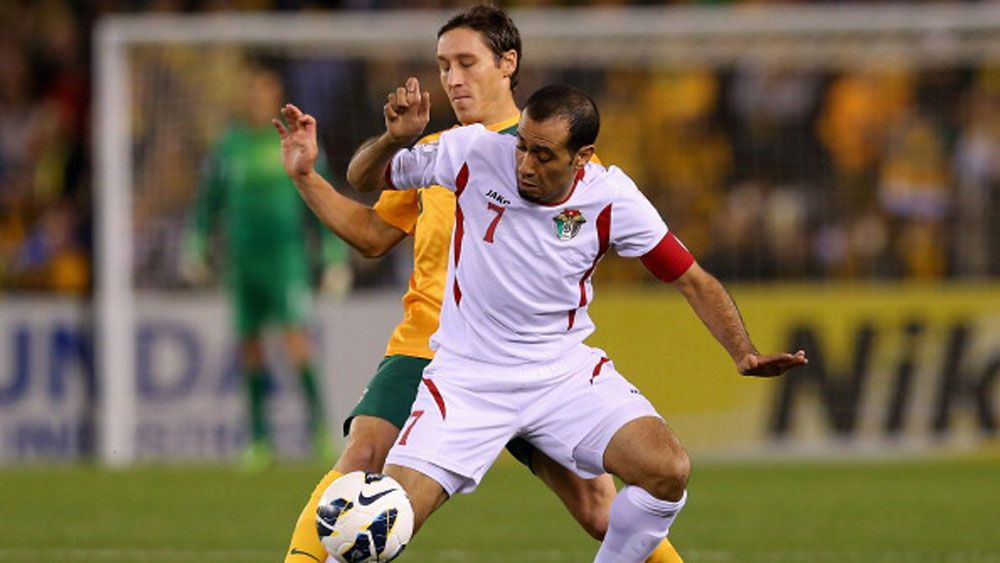 Socceroos midfielder Mark Milligan battles a Jordanian player for possession.(Getty)
