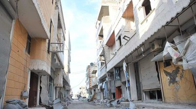 Collapsed buildings are seen in border town of Kobane after it has been freed from Islamic State fighters.