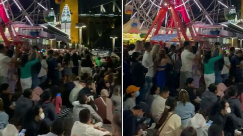 Videos posted to social media showed crowds of people at Luna Park on New Year's Eve.