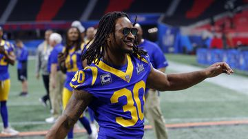 Los Angeles Rams running back Todd Gurley (30) rushes to join teammates for a photograph during walkthrough at the Mercedes Benz Stadium for the NFL Super Bowl 53.