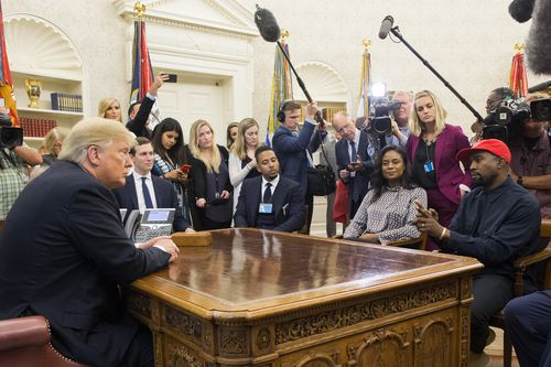 Trump conducts a bizarre audience with the rapper Kanye West on Thursday in the Oval Office.