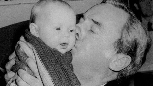 Then-opposition leader Bill Hayden kisses a baby while campaigning in Queanbeyan in Eden-Monaro in 1982.