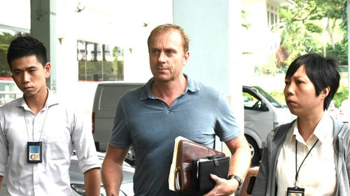 Craig Marran (centre) exits the Singapore mortuary. (Getty)
