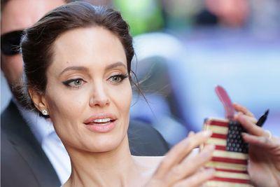 Angelina has a patriotic moment. Feeling homesick?