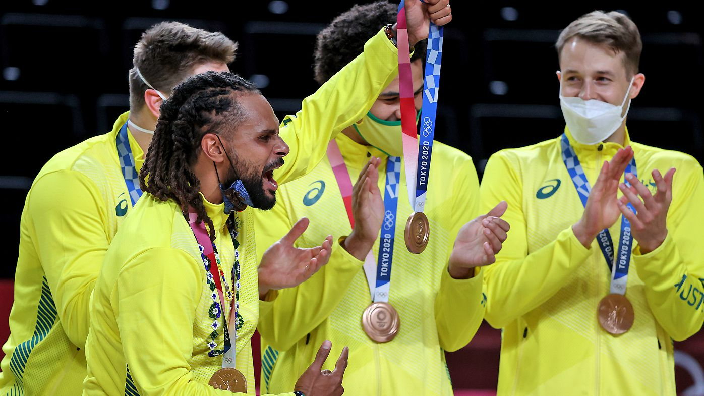 Patty Mills of Team Australia celebrates with his bronze medal during the Men's Basketball medal ceremony