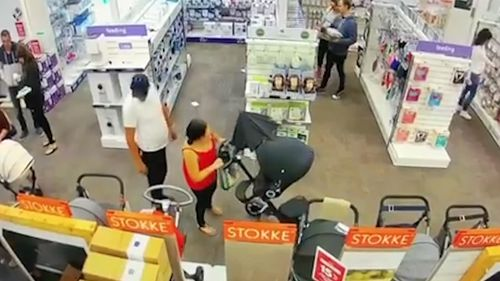 the woman chooses her desired pram and begins pushing it back-and-forth. Picture: Facebook