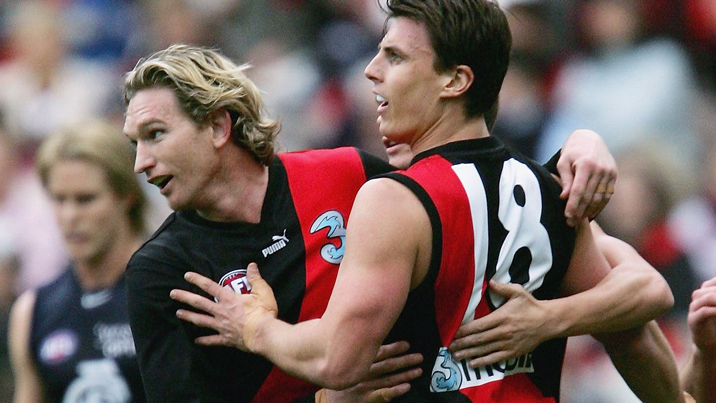 Essendon great Matthew Lloyd gets emotional recalling James Hird's mental health struggles