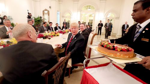 Donald Trump is treated to an early birthday cake whilst in Singapore ahead of the historic summit with North Korean leader Kim Jong-Un. (Getty)