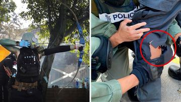 Hong Kong policeman pierced with arrow in violent protester clashes