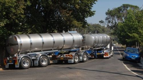 Tanker trucks take water bored from a bore near Stanley to the Asahi plant in Albury, NSW.