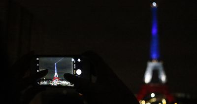 <p>The Eiffel Tower in Paris has been lit up in the national colours of blue, white, and red in honour of the victims lost in Friday's terror attacks. It marks the first time the iconic monument has been illuminated in the colours since the tragedy. (AAP)</p>