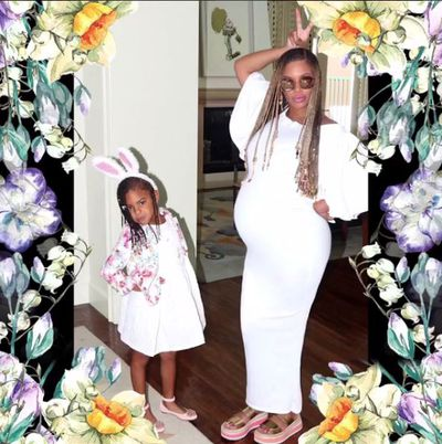 Playing bunny rabbits with daughter Blue Ivy who will soon be a big sister.
