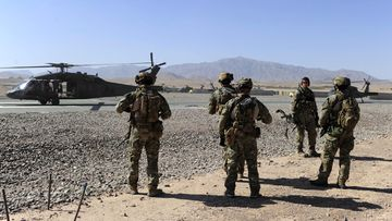 Australian Special Operations Task Group Soldiers move towards waiting UH-60 Blackhawk helicopters, in Afghanistan.