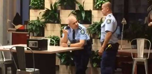 Police examine the safe