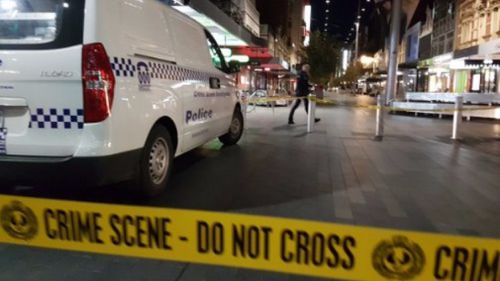 Man arrested over Adelaide CBD stabbings as victim fights for life