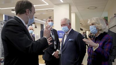 Britain's Prince Charles and Camilla, Duchess of Cornwall talk with Health Secretary Matt Hancock, left, and staff during a visit to the Queen Elizabeth Hospital in Birmingham, England, Wednesday Feb. 17, 2021, to thank volunteers undertaking clinical trials for the COVID-19 vaccinations.