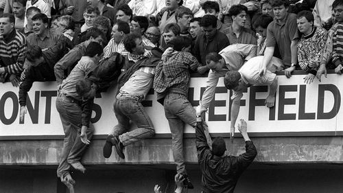A file photograph shows people scrambling for safety during the Hillsborough stadium disaster. (AAP)